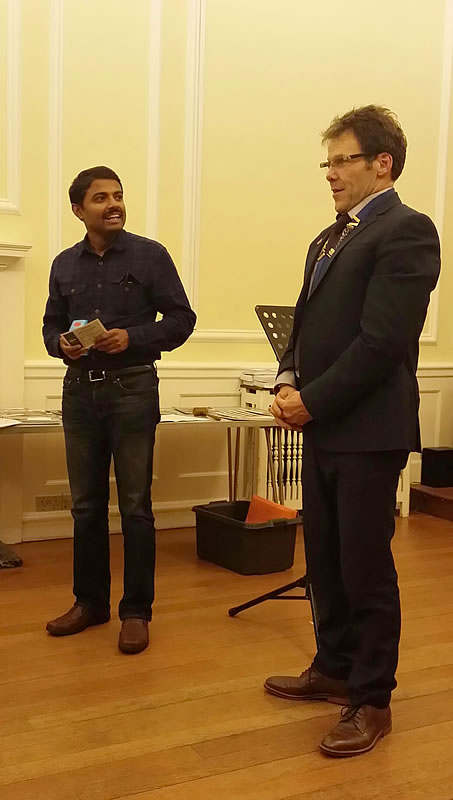 Vinod Venkatanarayana offers some praise to Club President Richard Green as he receives his award for best speaker of the evening.